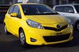 Yellow 2012 Toyota Vitz