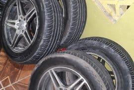 """15"""" Rims with tyre."""